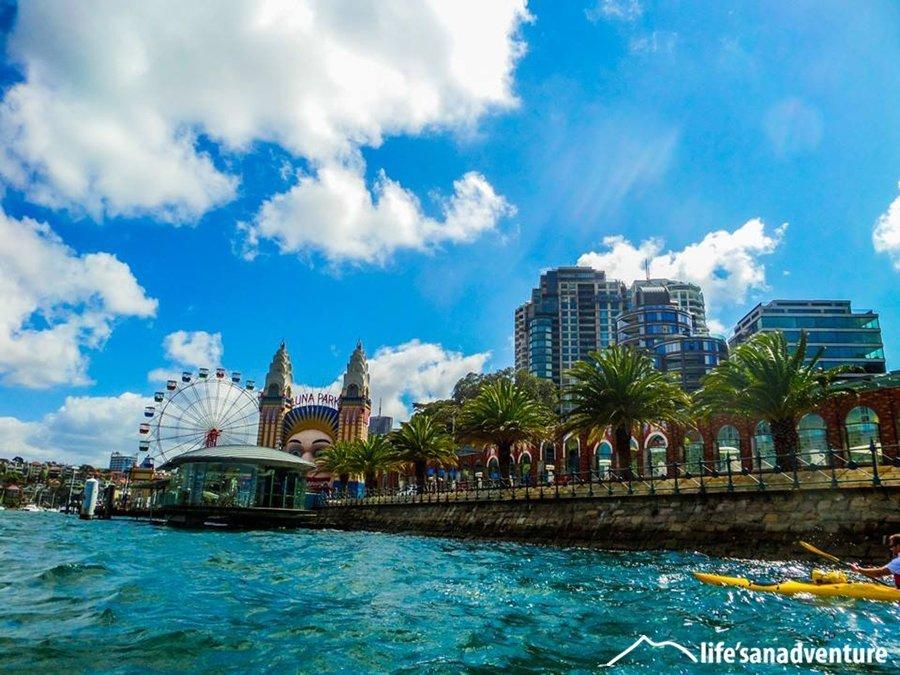 Kayak past Luna Park, Sydney Harbour