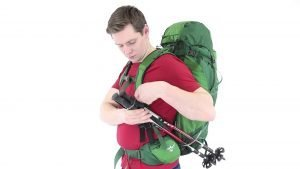 walking poles stowed on a back-pack